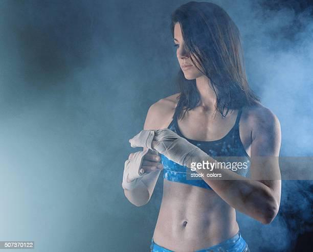 boxing woman preparing herself