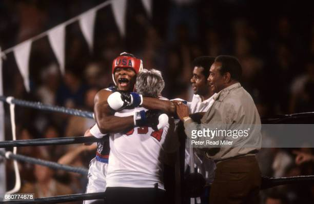 World Championships Challenge USA Ricky Womack victorious with coaches after winning fight vs Cuba Pablo Romero at Los Angeles Sports Arena Los...