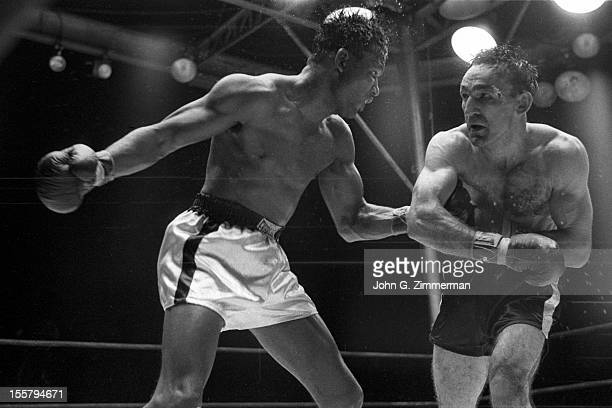 World Middleweight Title Sugar Ray Robinson in action punch vs Carmen Basilio during fight at Yankee Stadium Bronx NY CREDIT John G Zimmerman