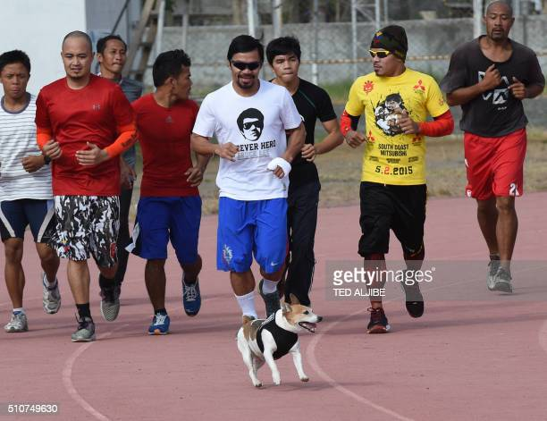 BoxPHIPacquiaoINTERVIEW by Karl Malakunas This photo taken on February 16 2016 shows Philippine boxing icon Manny Pacquiao jogging with fellow boxers...