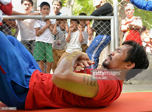 BoxPHIPacquiaoINTERVIEW by Karl Malakunas This photo taken on February 16 2016 shows schoolchildren watching as Philippine boxing icon Manny Pacquiao...