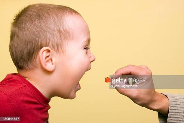 Boy, 2 years, getting a gummy bear