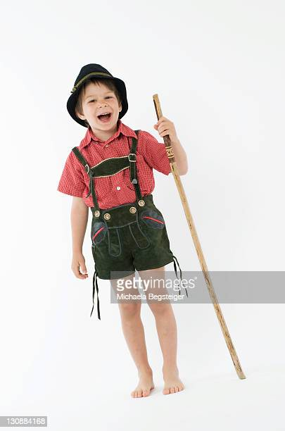 Boy, 4 years old, in traditional costume, with walking cane