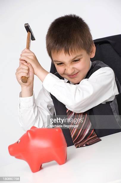 Boy, 8 years, robbing the piggy bank
