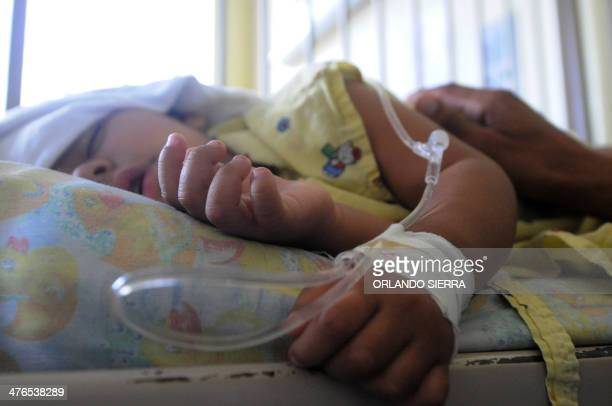 A boy affected by dengue fever rests at the pediatric ward of the University Hospital in Tegucigalpa on March 3 2014 Honduran officials issued a...