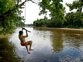 A boy age 12 on a rope swing along the Rappahannock River in Fredericksburg VA on June 18 2015 The mostly shallow slow moving river made for a good...