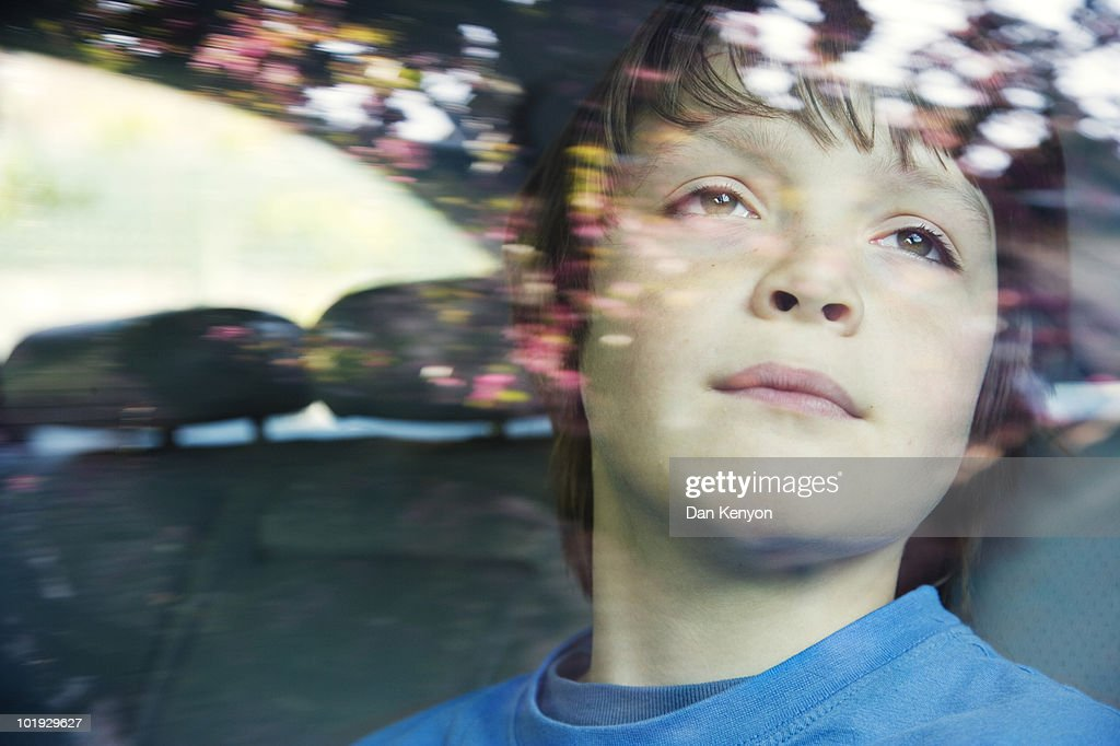 boy aged 10 in car. : Stock Photo