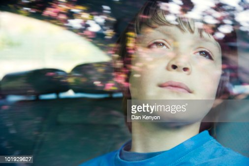 boy aged 10 in car. : Stock Photo