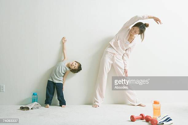 A Boy And A Woman Doing Exercise