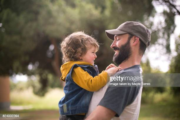 boy and dad smile