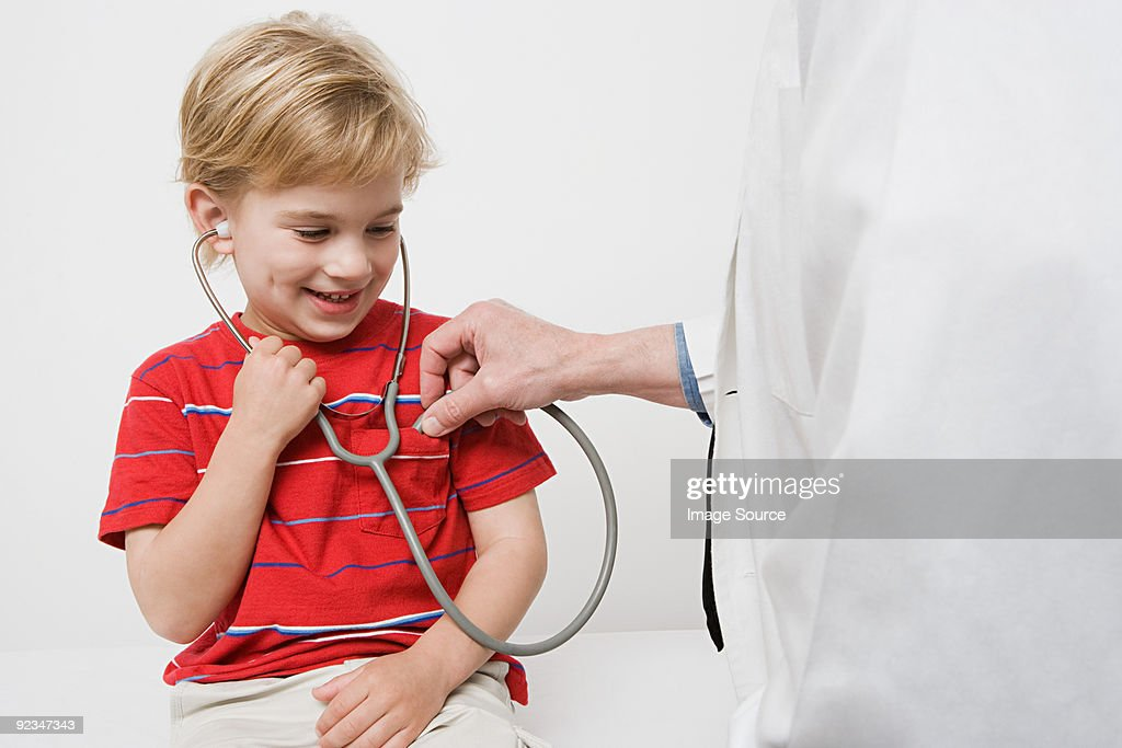 Boy and doctor with stethoscope : Stock Photo