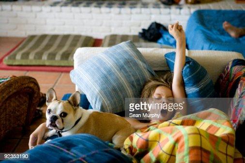 Boy and dog waking up