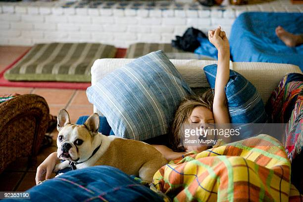 Boy and dog waking up