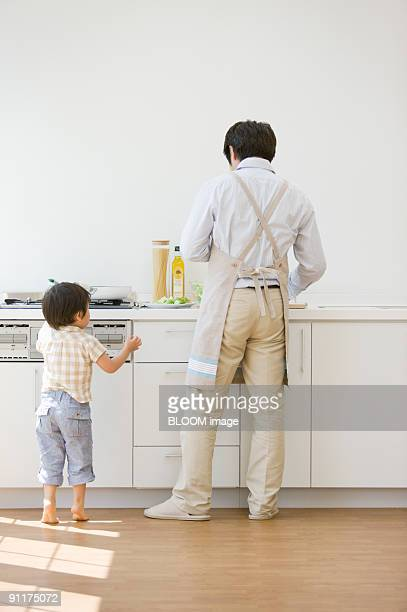 Boy and father in kitchen
