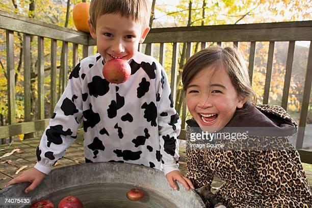 Boy and girl apple bobbing