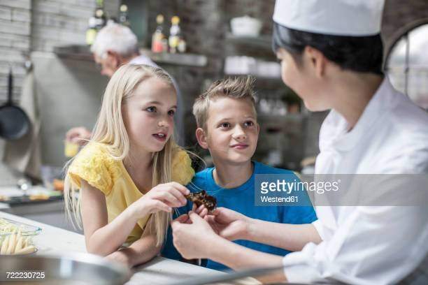 Boy and girl asking questions in cooking class