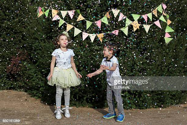 Boy and girl celebrating at a garden party