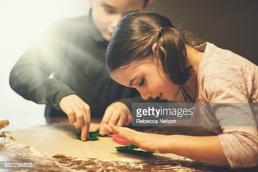 boy and girl cutting out Christmas cookies