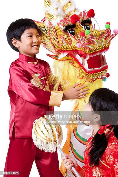 Boy and Girl Dressed in Traditional Clothing Celebrating Chinese New Year