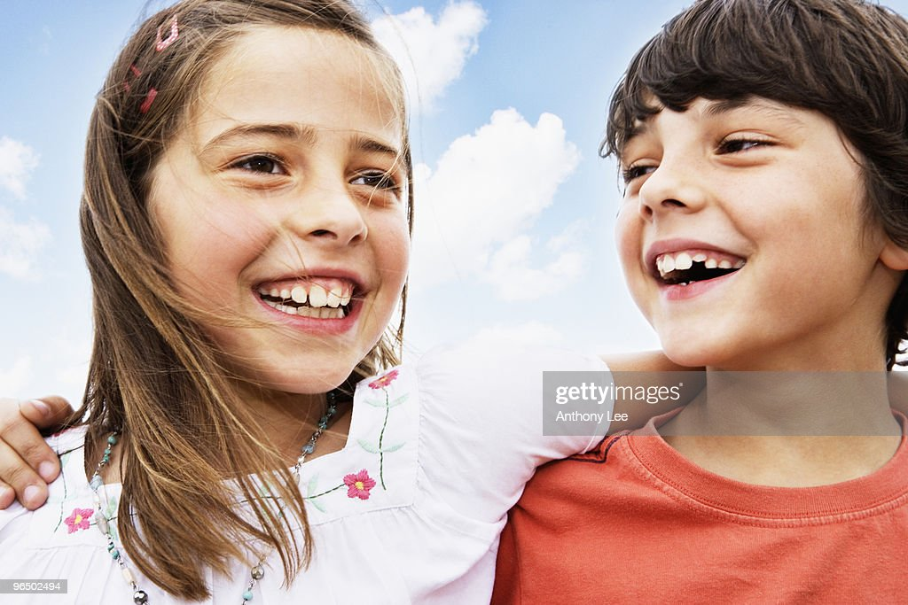Boy and girl hugging and smiling : Stock Photo