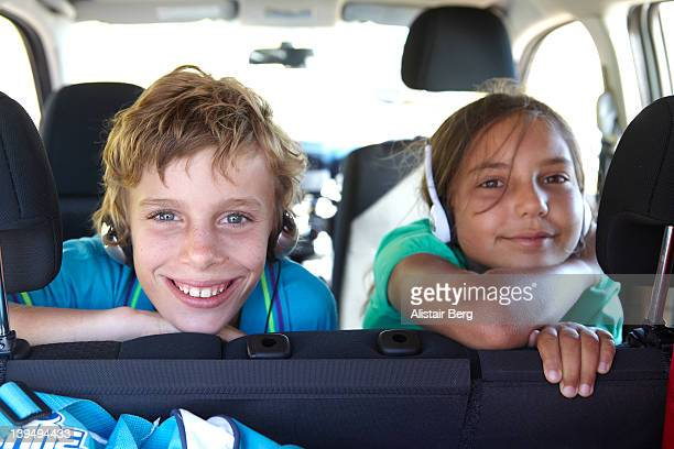 Boy and girl in back of car