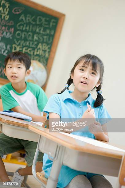 Boy and girl in classroom