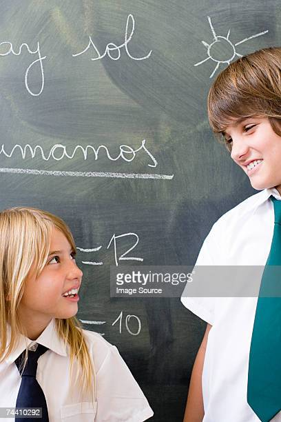 Boy and girl in front of blackboard