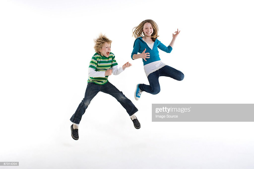 A boy and girl jumping
