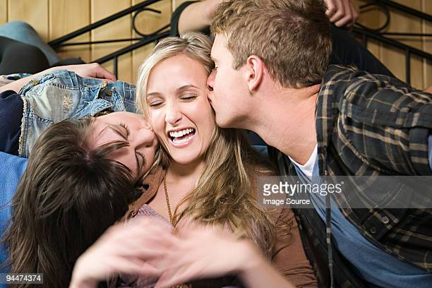 Boy and girl kissing  female friend
