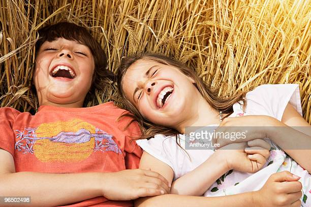 Boy and Girl laying in wheat field
