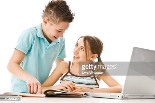 Boy and girl learning together with a computer : Foto de stock