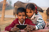 Boy and girl looking at smart phone