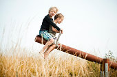 Boy and girl on a seesaw
