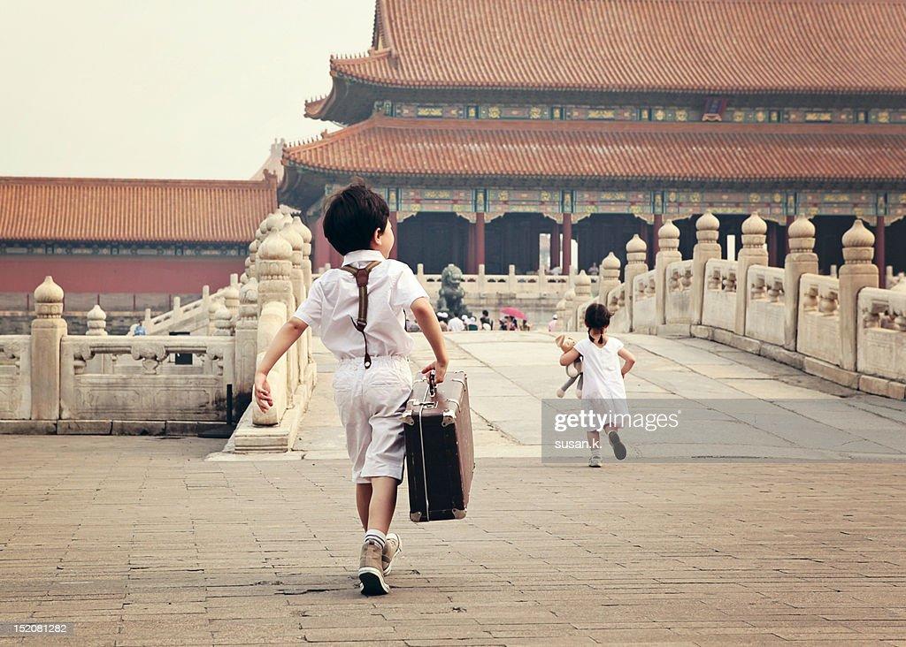 Boy and girl on bridge : Stock Photo