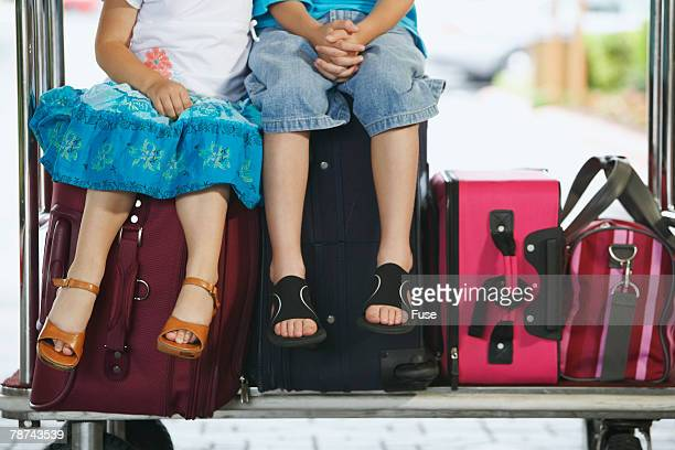 Boy and Girl on Luggage Cart