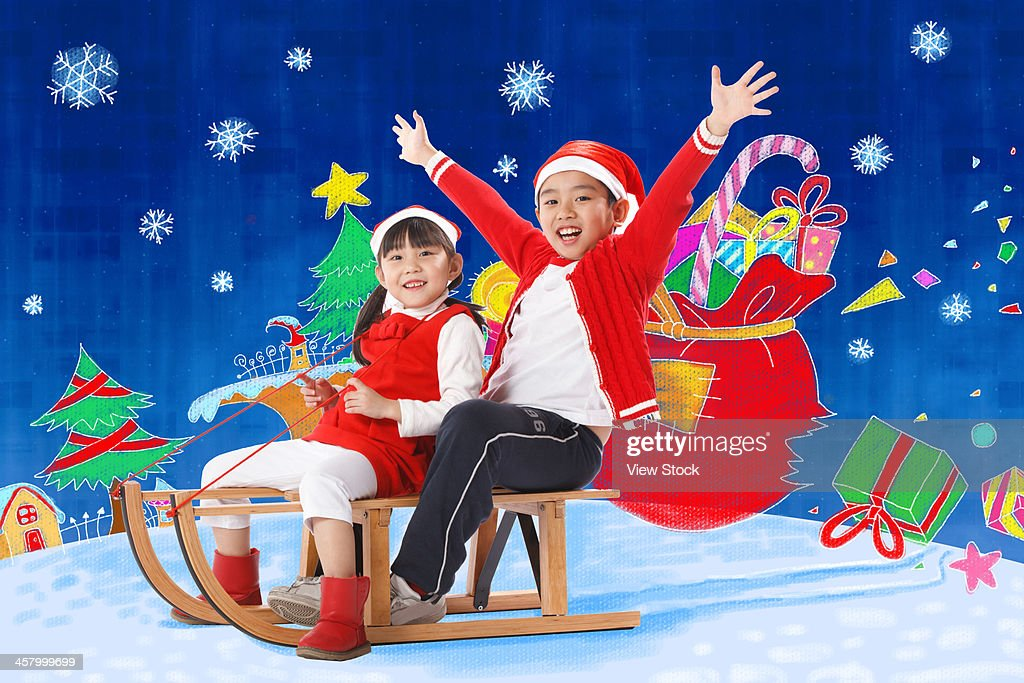 Boy and girl on sled
