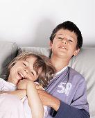 Boy and girl on sofa