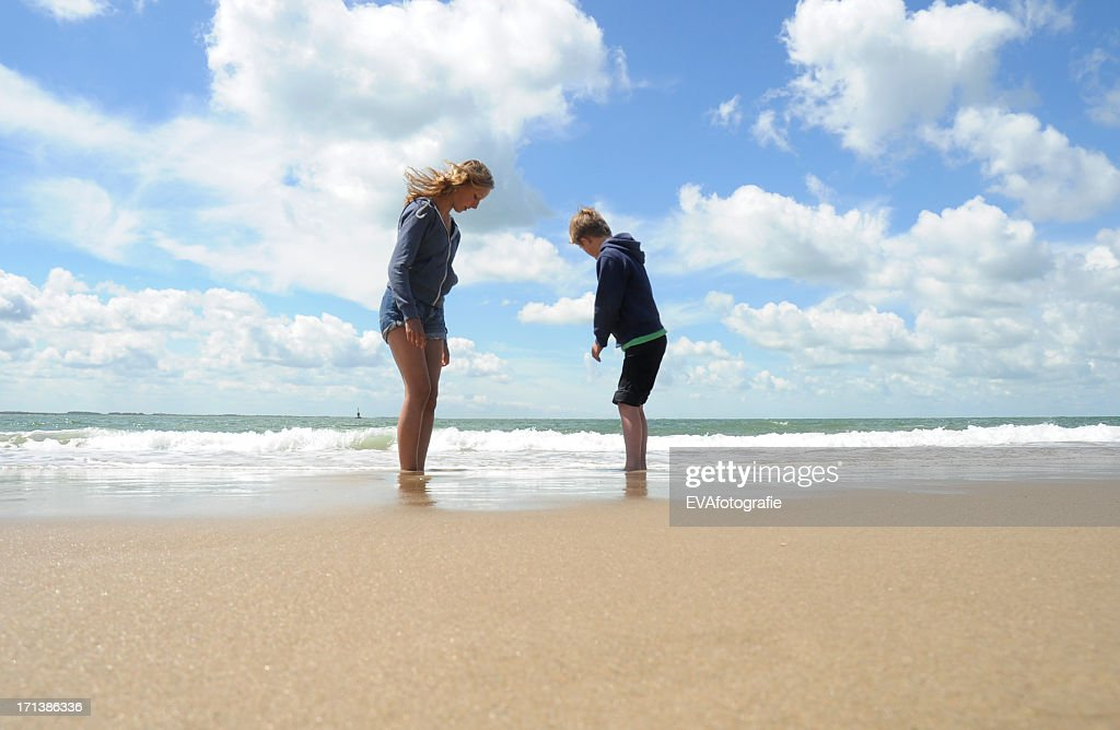 Boy and girl on the beach