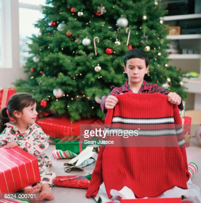 Boy and Girl Opening Presents