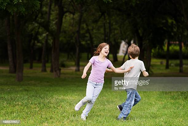 Boy and girl playing in the park
