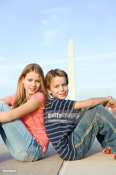 Boy and girl posing at Washington Monument