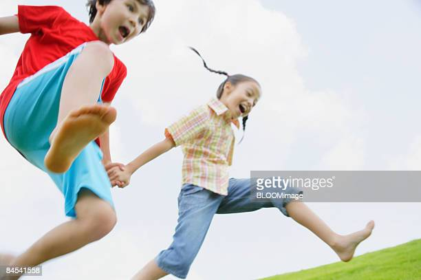 Boy and girl running hand in hand