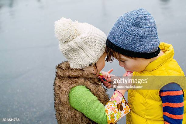 Boy and girl sharing sweets