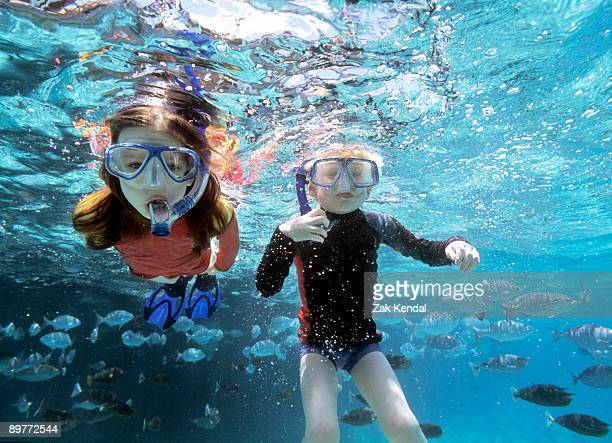Boy and girl snorkeling
