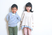 Boy and girl standing still with smile