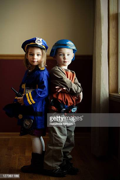 Boy and girl twins dressed up as police officers