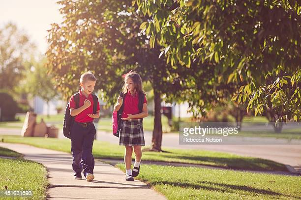 Boy and girl walking home from school