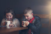 boy and girl warming up with some hot chocolate