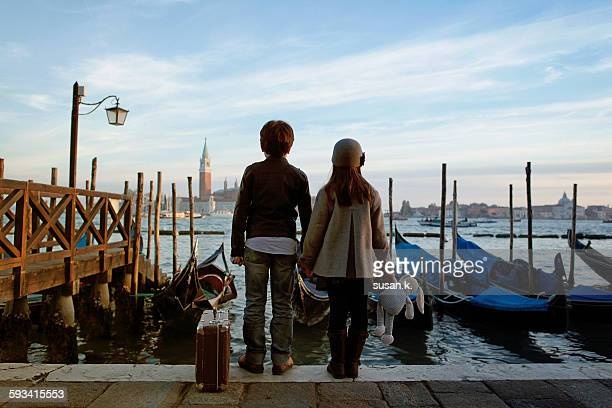 Boy and girl watching sunset at Grand Canal