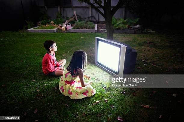 Boy and girl watching television